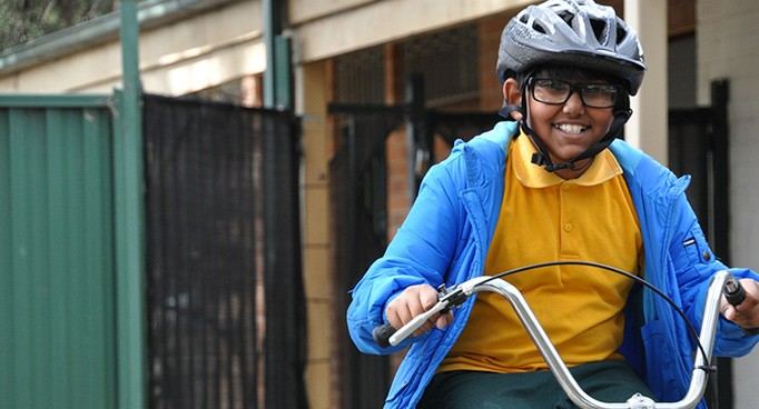 One of our smiling students enjoying riding a bicycle.